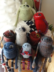 Monster friends created from upcycled old sweaters.